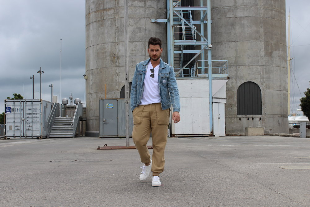 Jaheb Barnett wearing deus ex machina pants, calvin klein jacket and french connection shoes