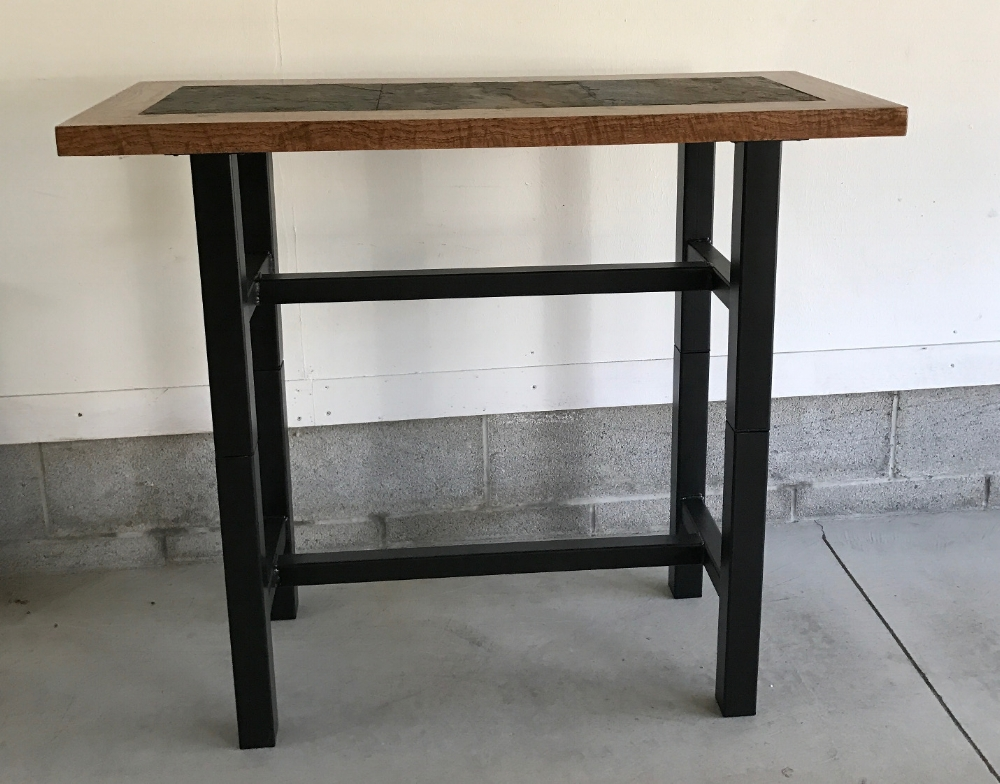 "Seen here is a Custom Ordered Table 36"" Tall x 42"" Wide x 18"" Deep. The Top is Highly Figured White Oak with Inlaid Natural Slate and a Hand Rubbed Tung Oil Finish. The base is Tube Steel with a Rubbed Oil Bronze finish. At times it will be used as an Kitchen Island."