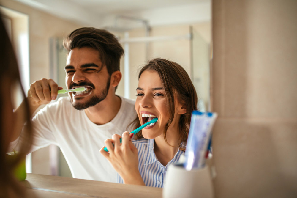 couple brushing teeth.jpg
