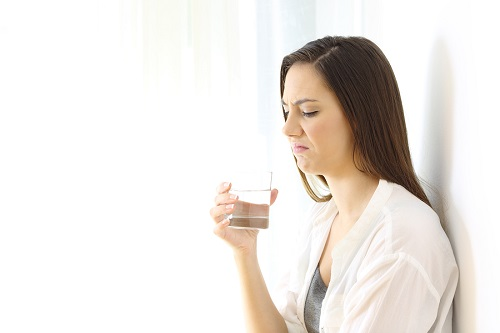 bigstock-Disgusted-Woman-Drinking-Water-214373410.jpg