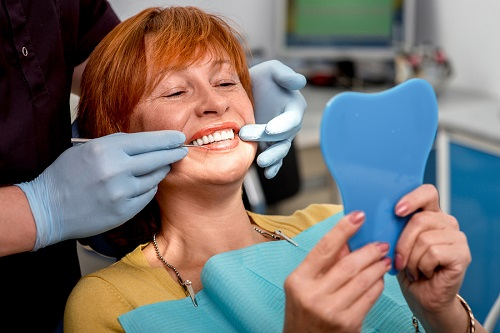 bigstock-Senior-woman-in-the-dental-off-77401595.jpg