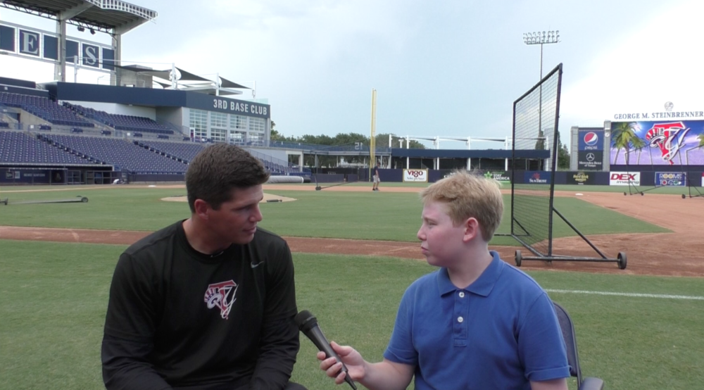 Talking with Tampa Yankees hitting coach Eric Duncan on the field at George Steinbrenner Field.