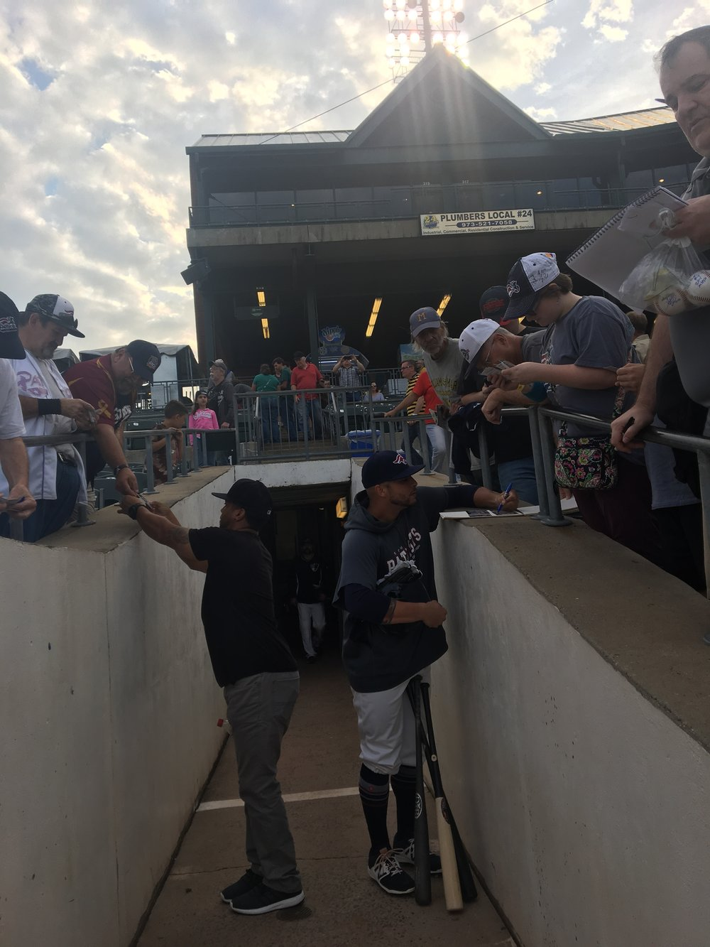 The fans waiting over the tunnel to get autographs.