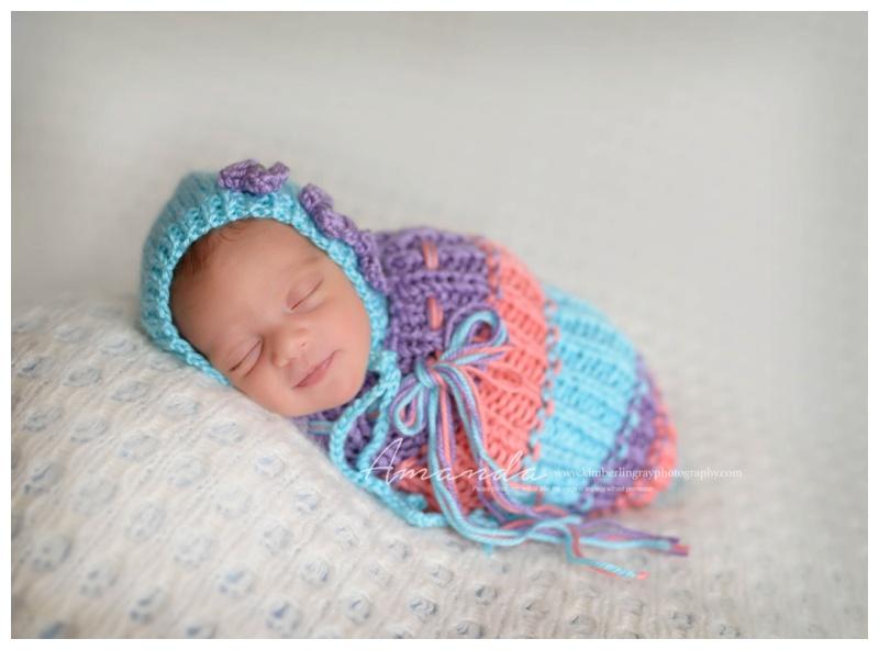 Cozy newborn poses