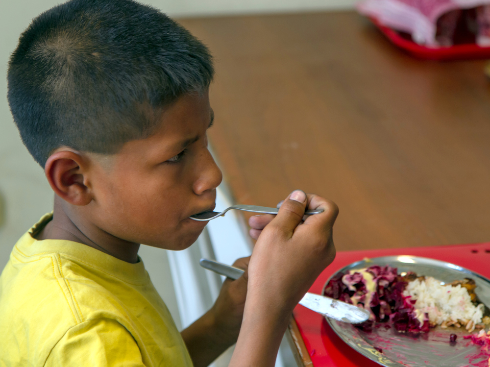 Boy eating rice-001.JPG