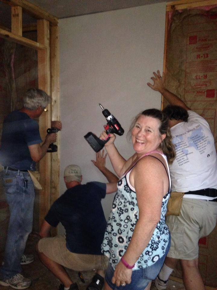 puttig up drywall with a smile.png