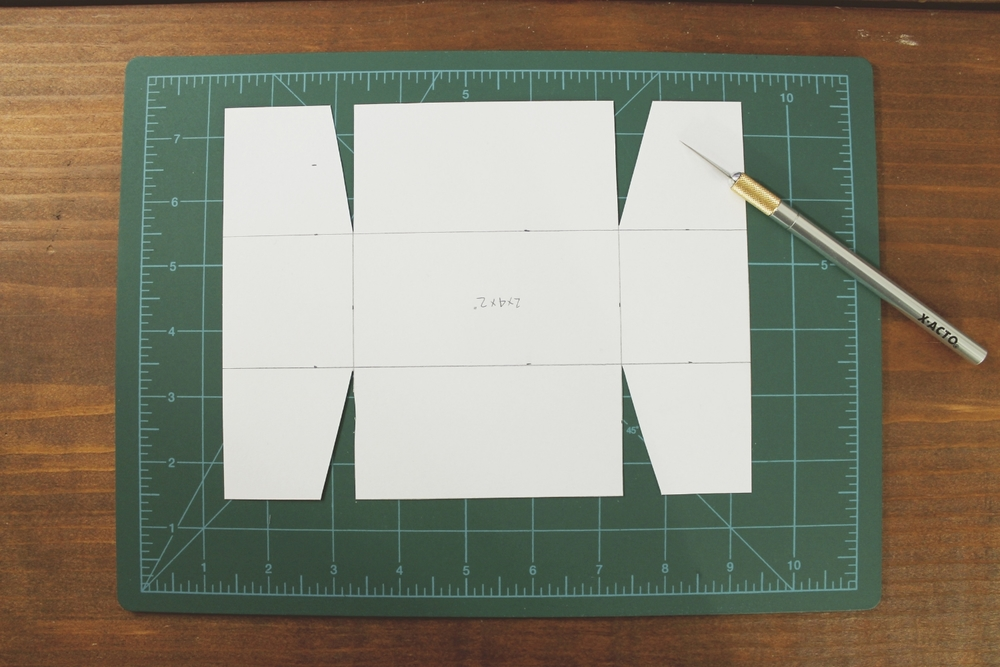 Cut out little triangles - this helps when you fold up the corners