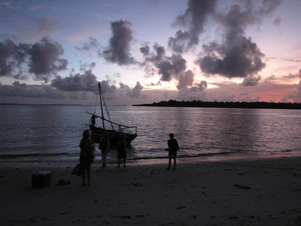 Waiting for our boat to take us to the sandbank for sunrise yoga flow and picnic