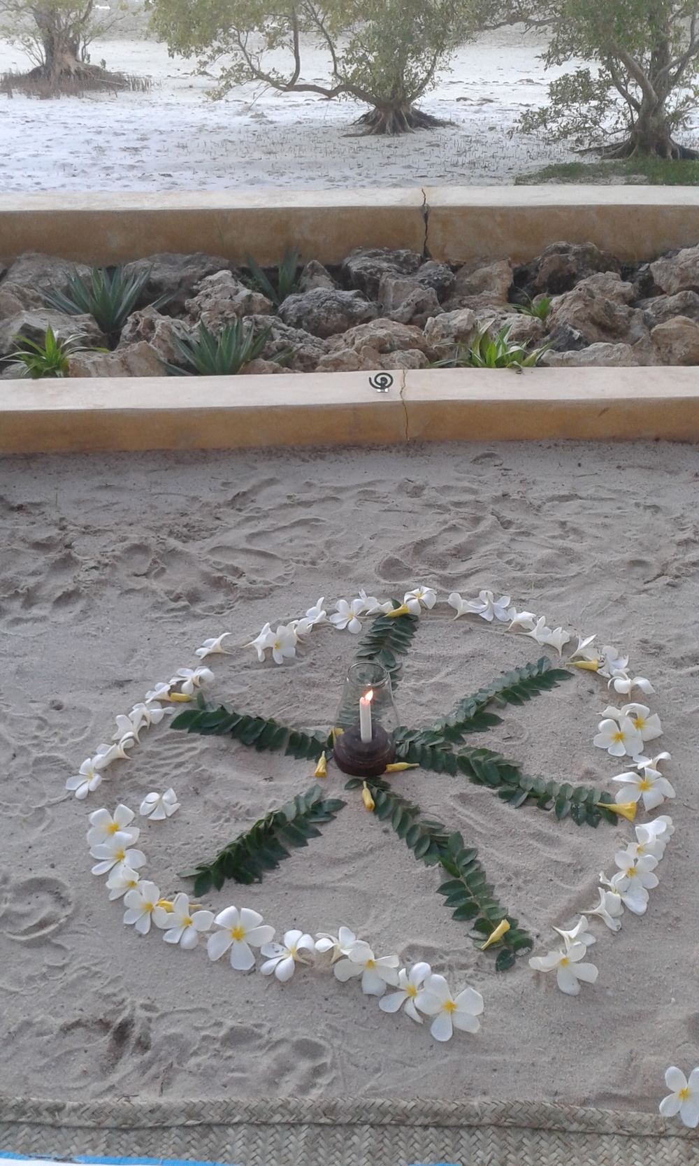 A flower mandala whisked away by the wind... a symbol of impermanence in life