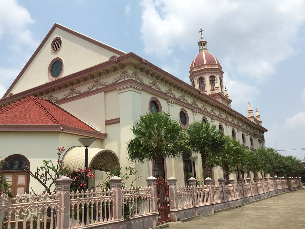 Santa Cruz Church, playing a central role in the Kudee Jeen community.