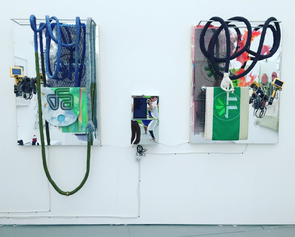 "(L) Static Void: All You Need To Attract Click-Throughs, 2016, 50""x34.25"", metal, fabric, ink, acrylic on mirror plexi, robotic arms, animations on monitors.(R) Host: You Need To Upload Two Different Versions, 2016, 49""x37"", metal, fabric, ink, acrylic on mirror plexi, robotic arms, animations on monitors."