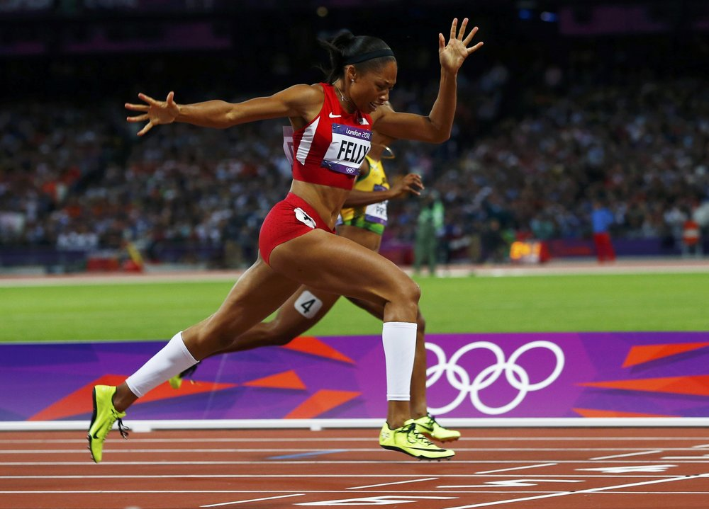 Allyson Felix showing how you close out a race.