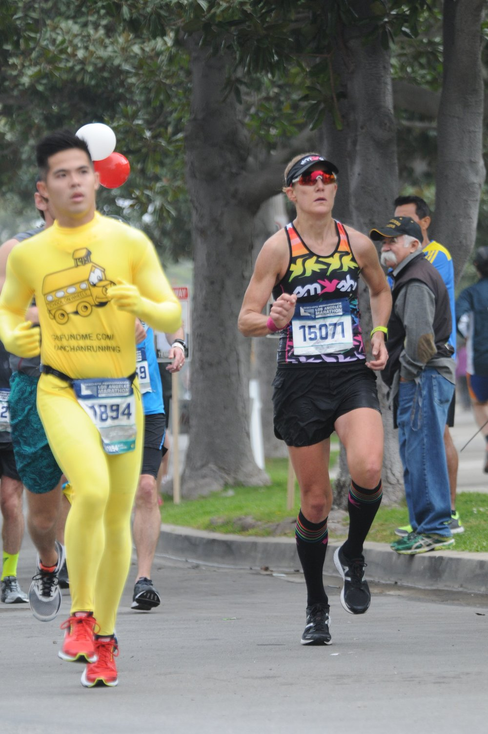I love this photo, I think I look pretty tough, but for the record, the guy in the yellow onesie beat me across the finish line.