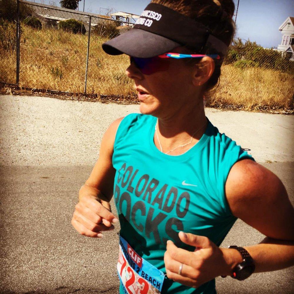 My athlete and sister, Sarah Fox cruising through mile 24 of the Mountains to Beach marathon, 2017.