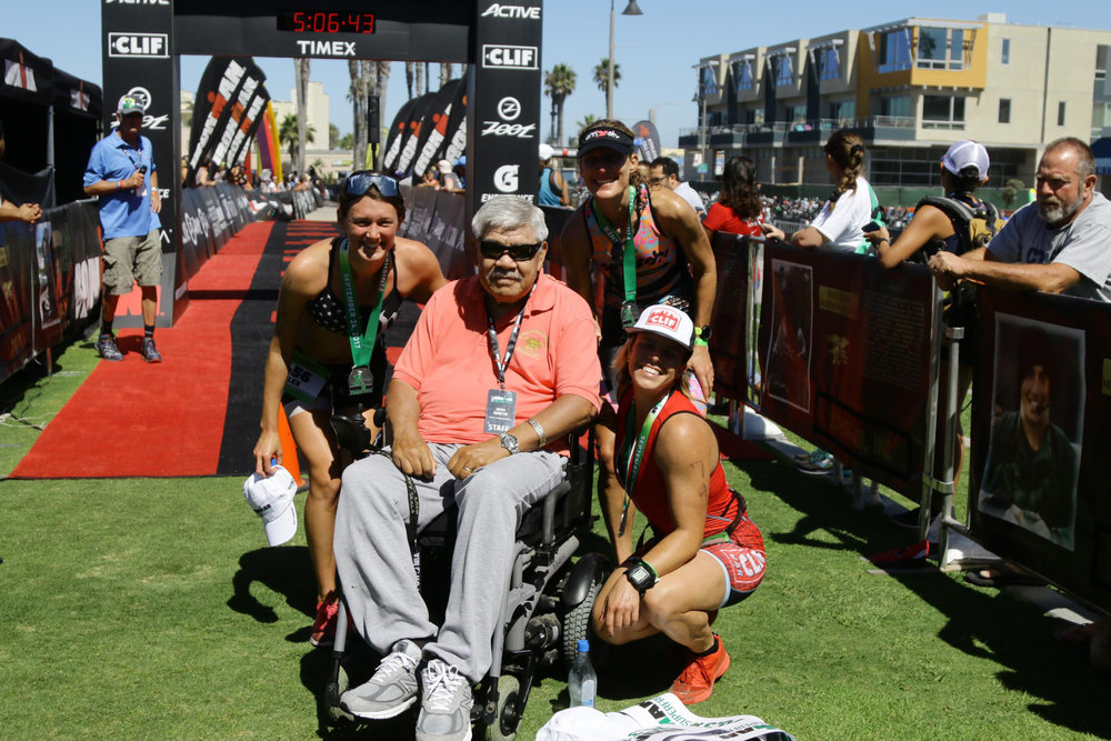 The top 3 women posing with the original race director, and legend, Moki Martin.