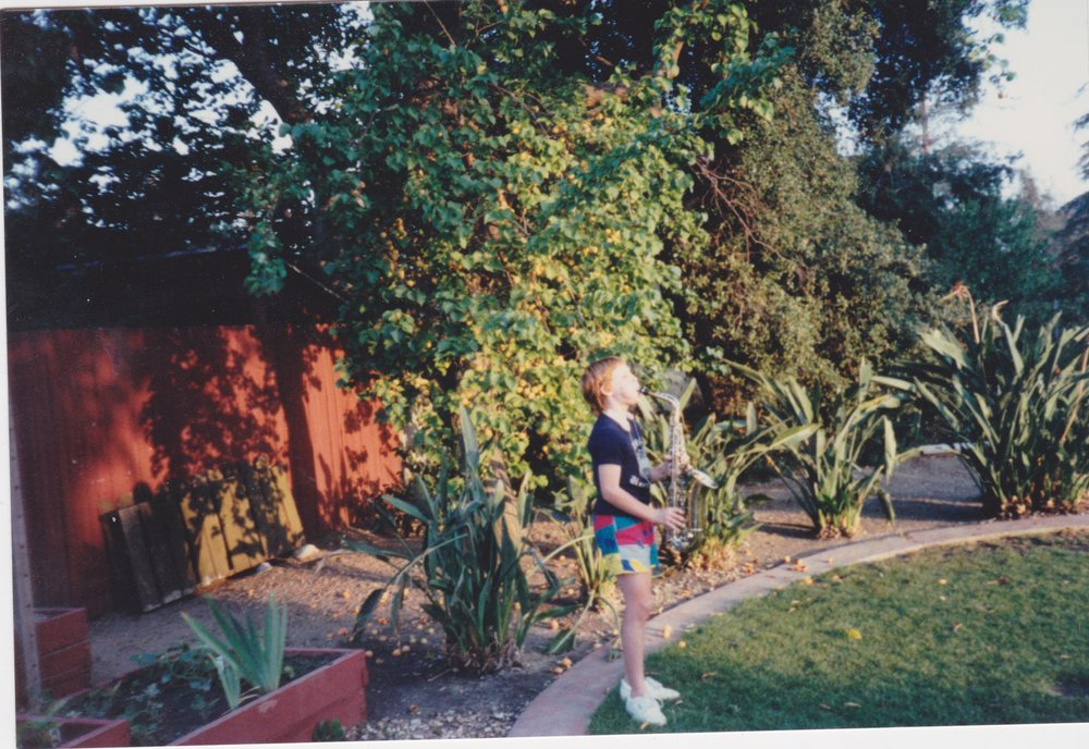 "Circa 1987, yours truly practicing the saxophone. This backyard stage would later be used as the set for my first talk show, ""Kelly"", which ran for two seasons in 1989 - 1990.:)"