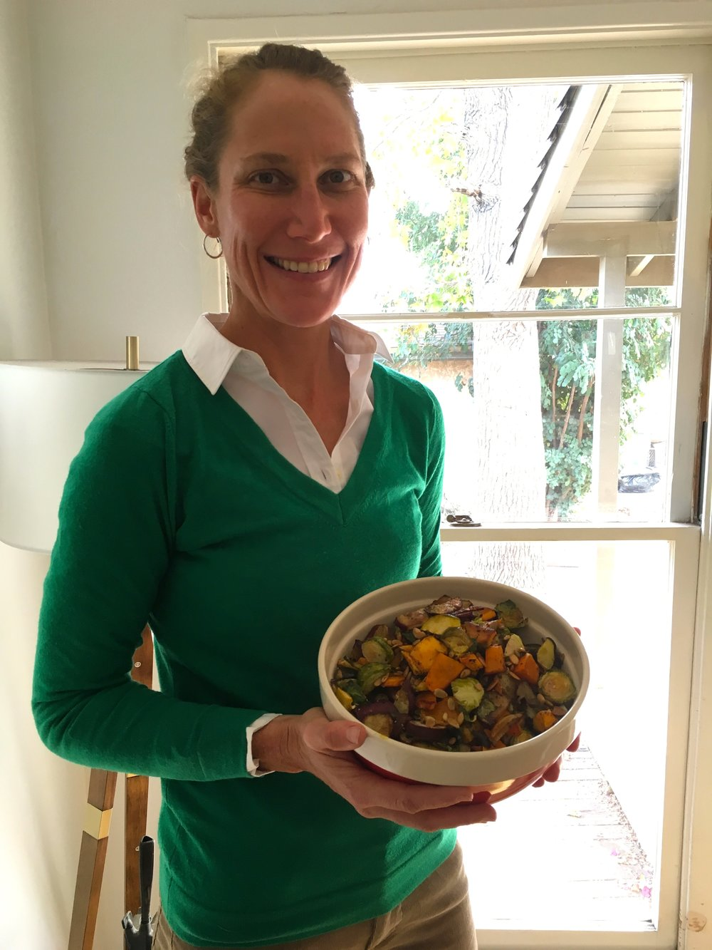 Yours truly with a bowl full of roasted veggies:Murasaki sweet potatoes, butternut squash, acorn squash, brussel sprouts, almonds, sage, and pepitas.