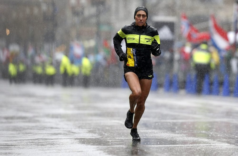 This photo of the women's winner, Desiree Linden, says it all. It was a tough race for all of us.