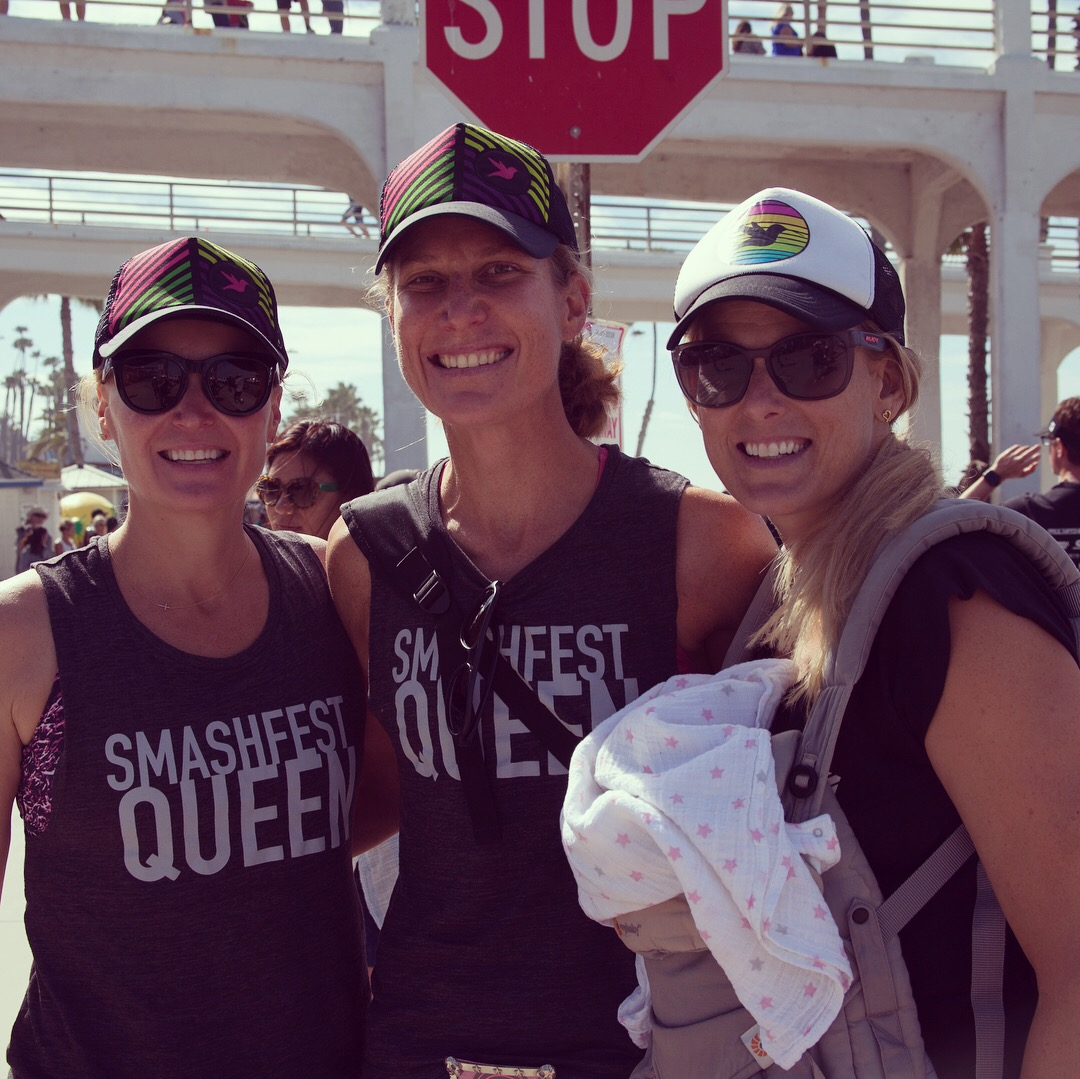 Smashfest Queen sandwich, Michele Landry, a tall red head, young Hill Biscay, and Hillary Biscay cheering on the team at Oceanside 70.3 last April.