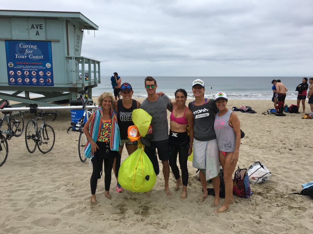Post SMOG swim. Starting from screen left, Lynne Fielder, Hillary Biscay, Bryan Mineo, Jenn Aronson, a local, and Lynne Caraway.