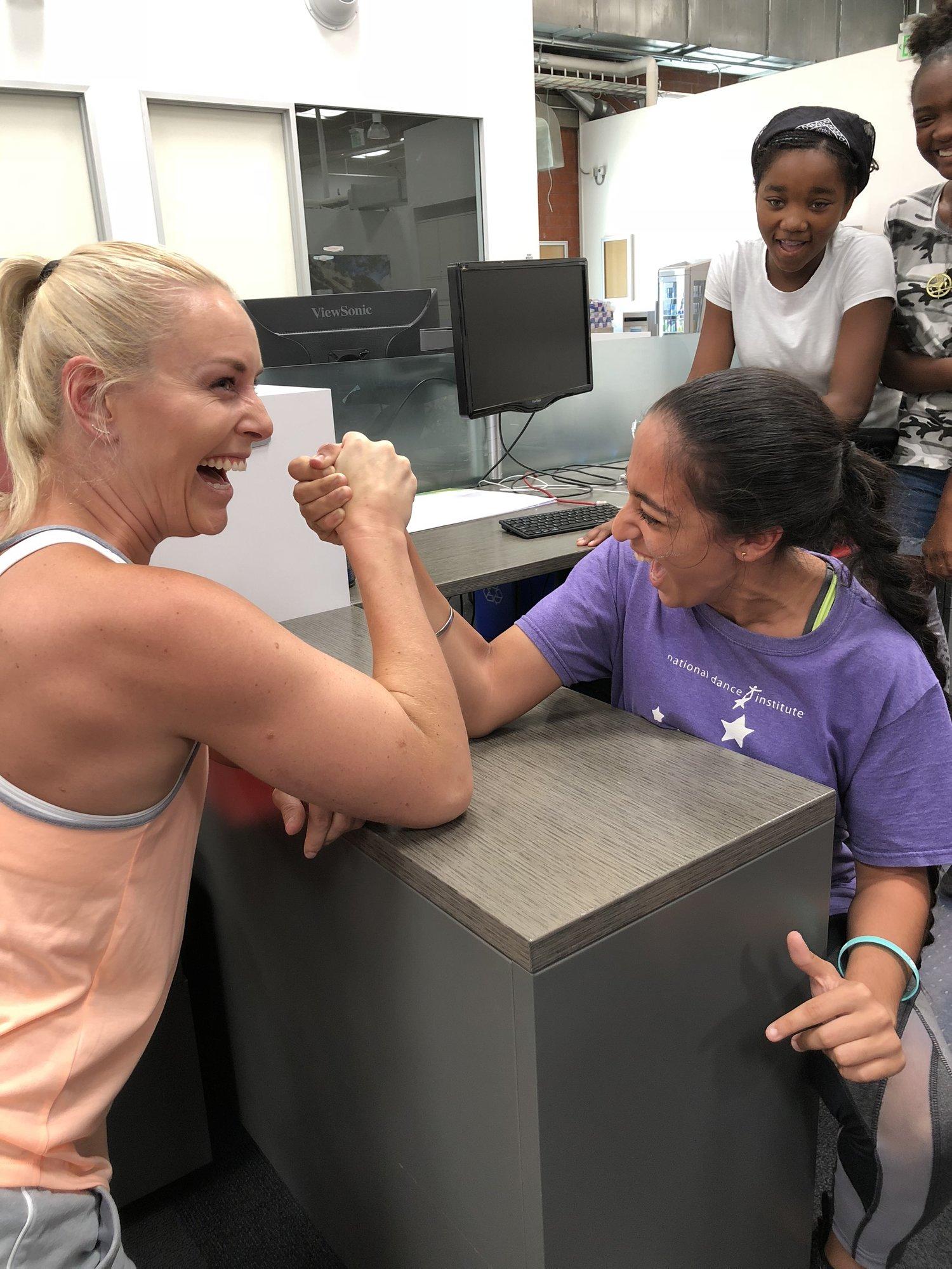 Lindsey taking on an arm-wrestling challenge.