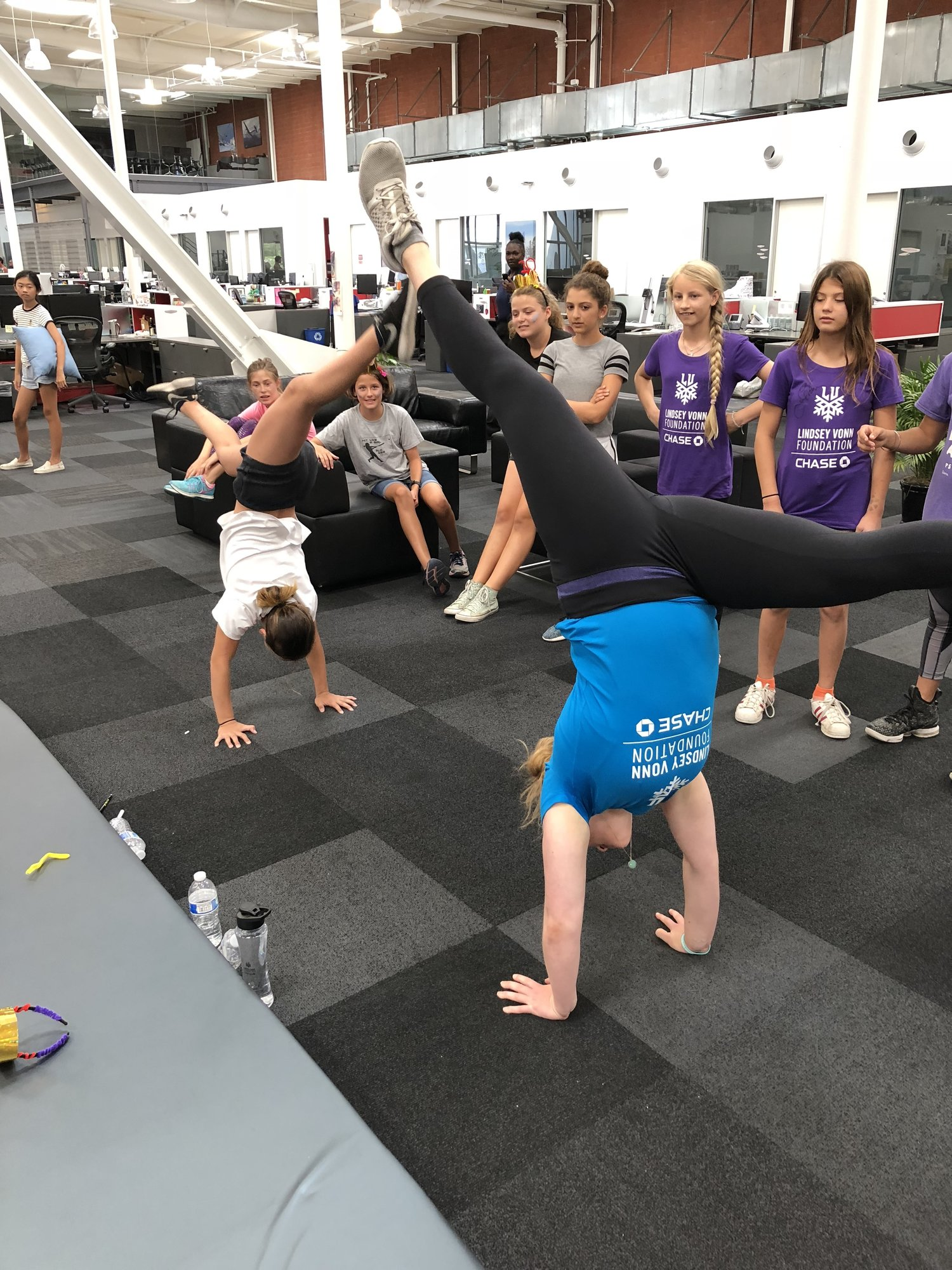 Camper/mentor handstand contest. An average activity at an all girls athlete camp.