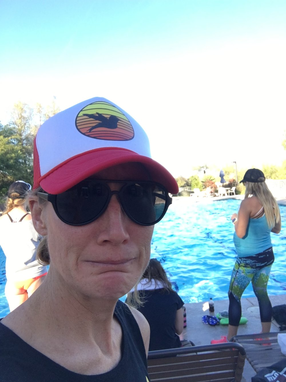 Screen left, a nervous triathlete about to jump into a swim skills session at Triathlon Camp in January under the watchful eye of her super-swimmer coach, screen right.