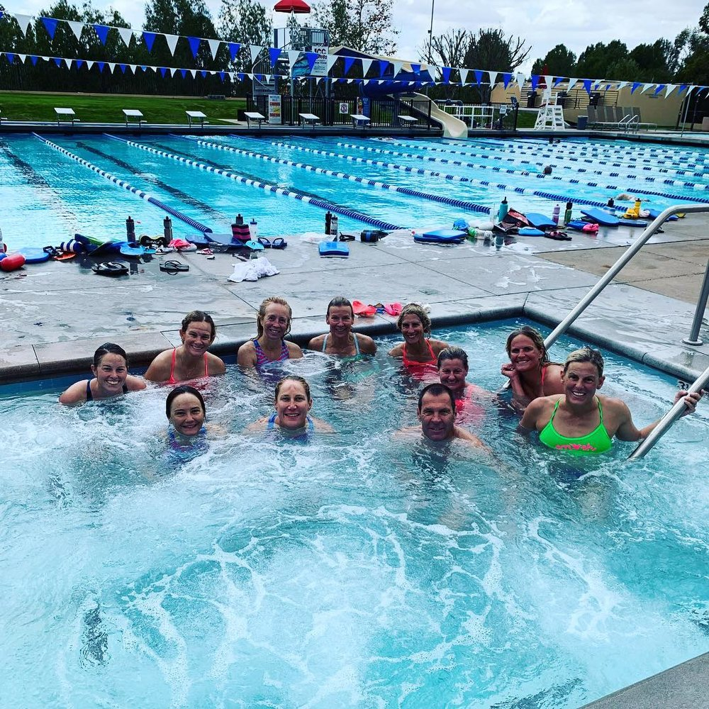 My TeamSFQ teammates and  SmashfestQueen  founders, Hillary Biscay in green, Michele Landry shooting the photo, enjoying a well-deserved hot-tub soak after completing our 100x100's New Year's Eve Swim workout. Photo courtesy of Jennifer Kenney Plumb