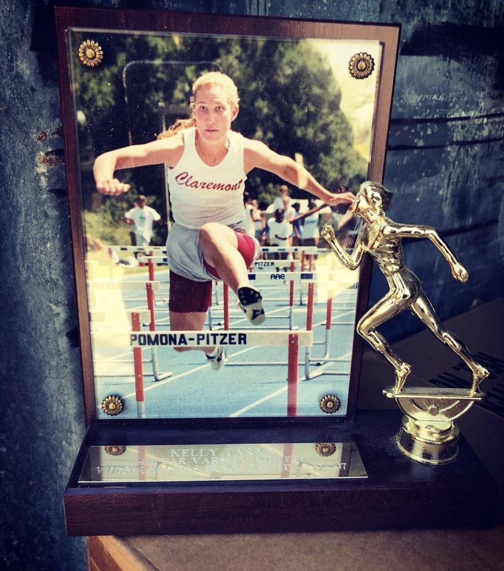 Racing the 100M hurdles at the Claremont Invitational, 1997.
