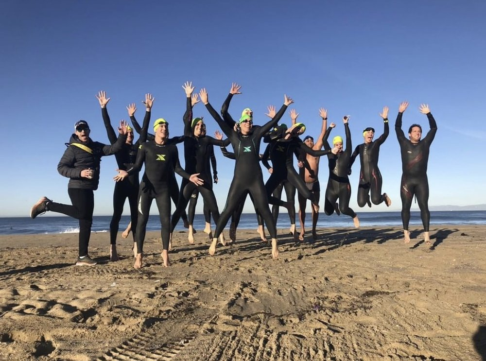 The nutty members of SMOG who delight in swimming in mid-winter conditions. Photo courtesy of Courtney Clifford Mineo.