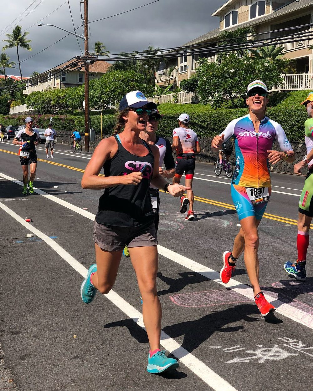Sarah running alongside her coach last October at the Ironman World Championship in Kona, HI.