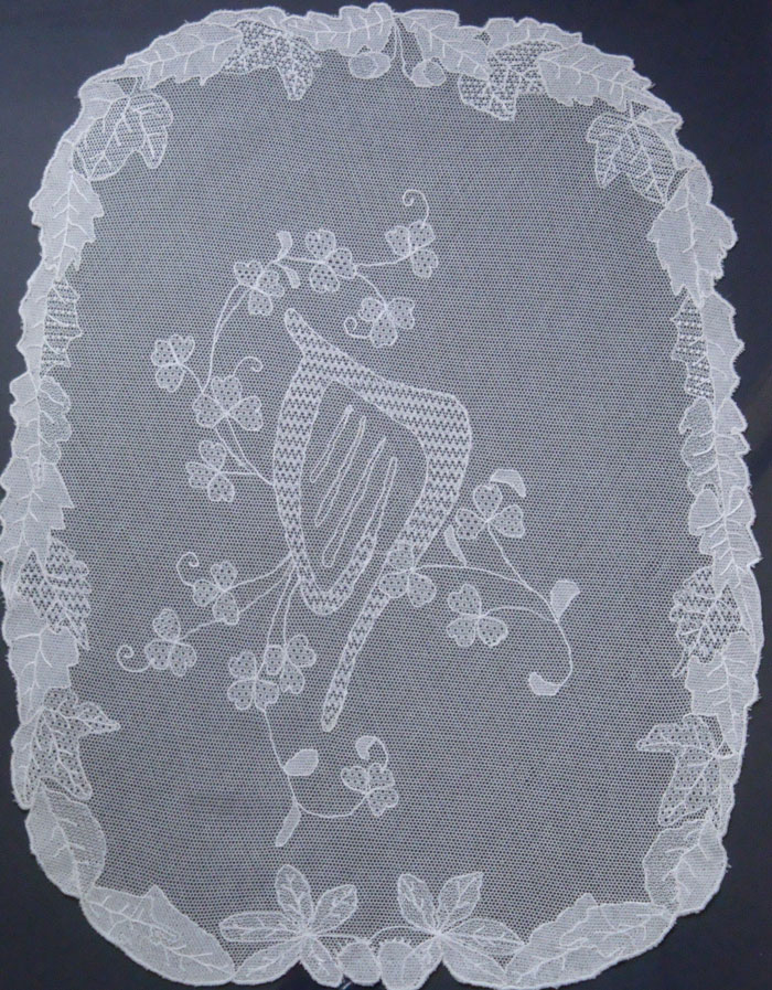 TLI Crest worked in Limerick Lace by the late Phil Larkin.