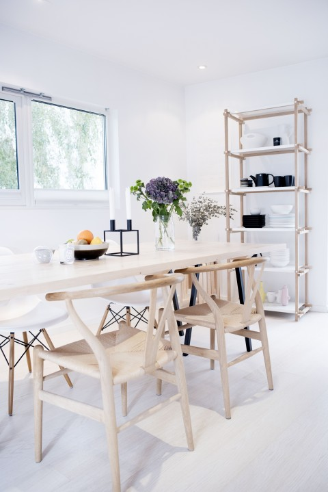 Mixing up chairs for a didning table makes a space feel a little less formal and more personal.