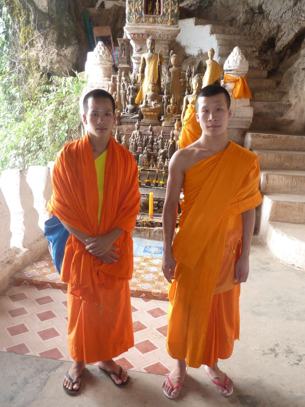 Sone and Vixai at a Buddhist shrine along the Mekong River.