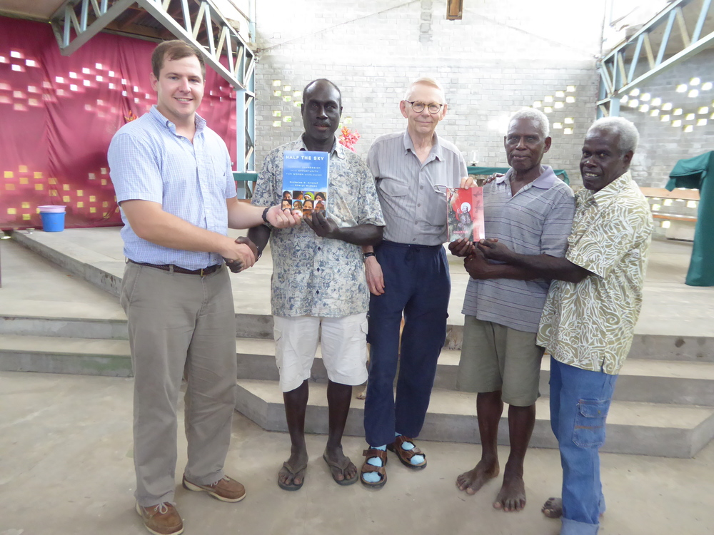 Bill presents a copy of his biography of St Francis of Assisi to lay church leaders in Bougainville, Papua New Guinea.  To the left is Jacob Surface, a US diplomat and former student of Bill's, who arranged for Bill's visit there.