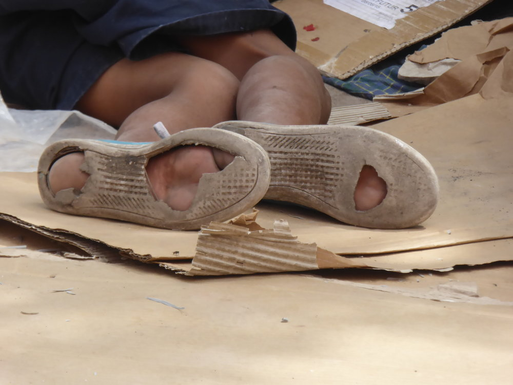 These are the feet and shoes of a homeless boy in Tegucigalpa, Honduras. We are supporting the recruitment of vulnerable boys and girls into Covvenant House (Casa Alianza) before they are forced into gangs or are trafficked.