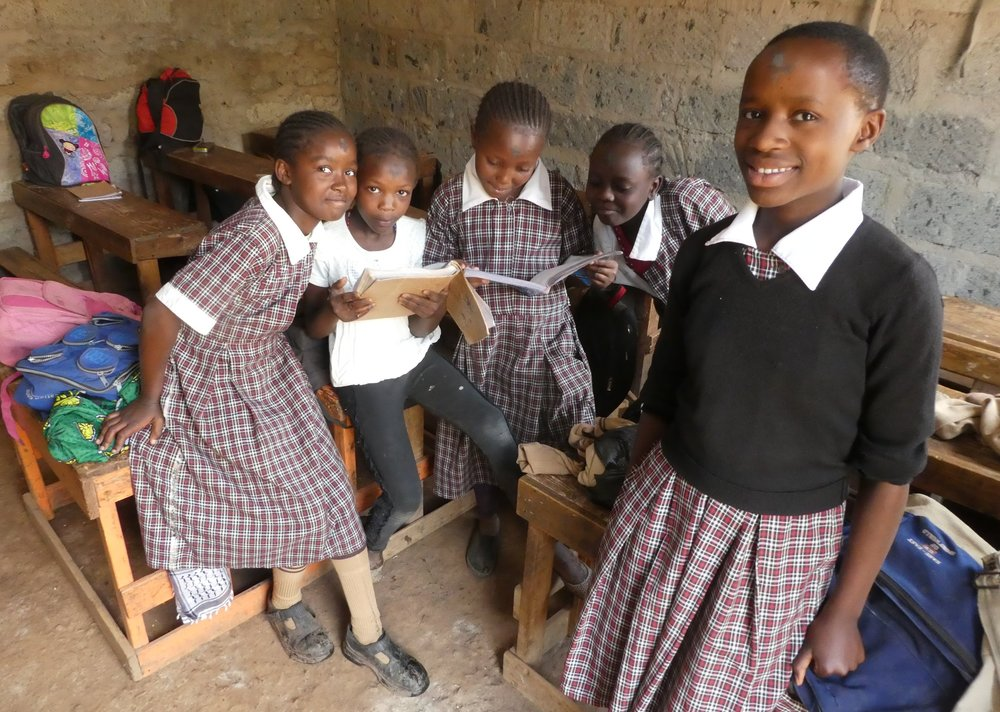 Girls from Mathare, Kenya, wearing their school uniforms. Thanks to your support, the Foundation has provided major support for their school, Mamma Africa.