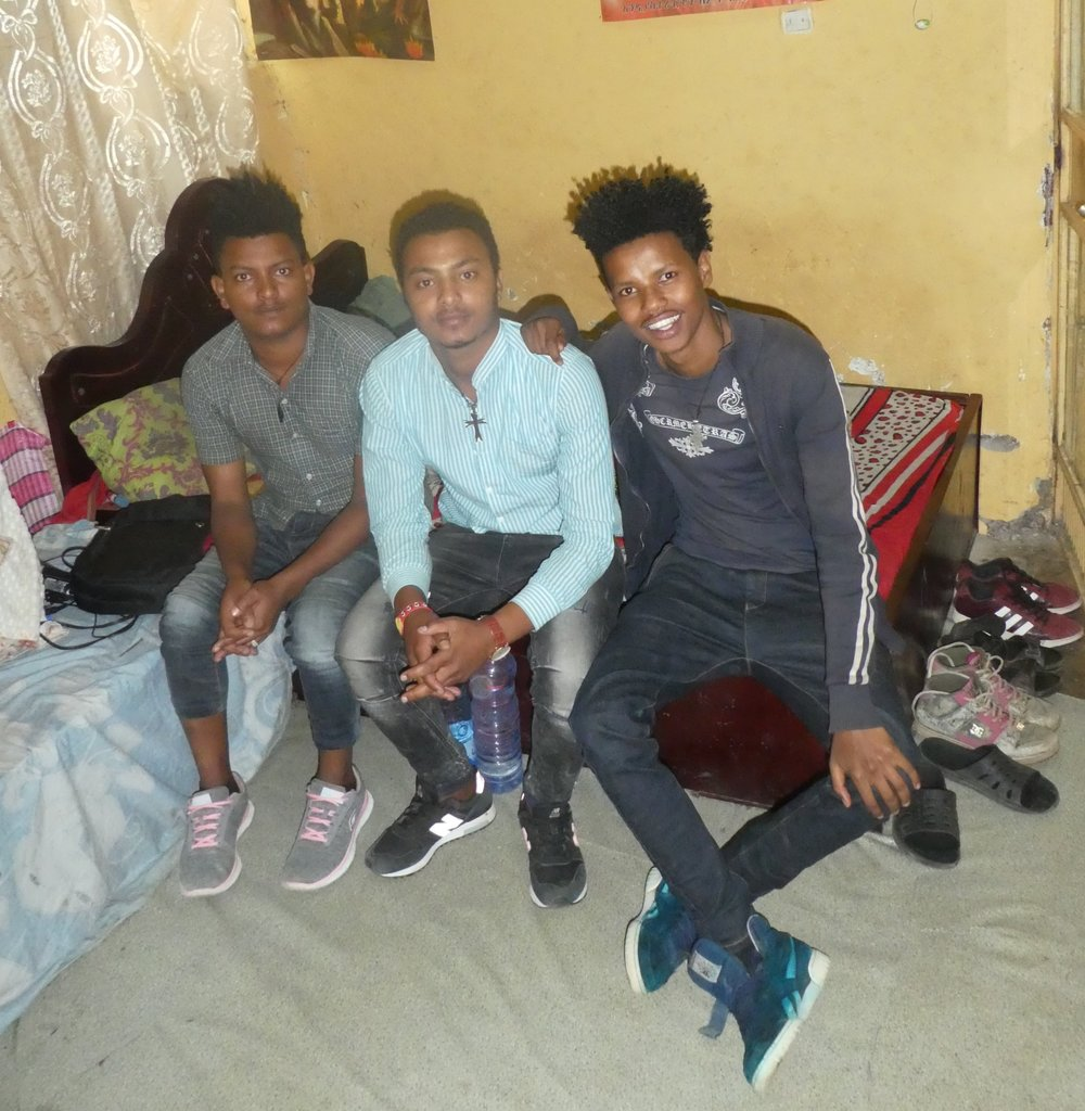 The three young Ethiopian men in their modes' room in Addis Ababa.