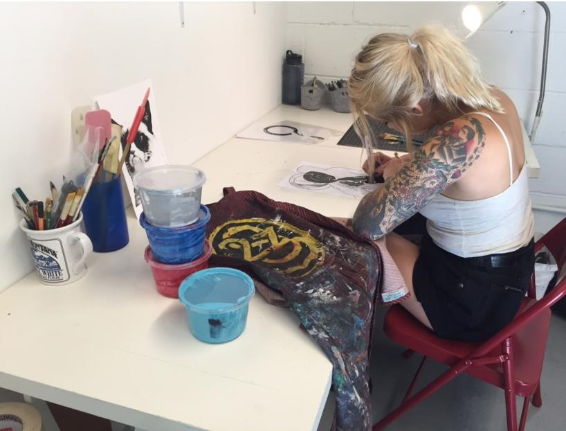 ARTIST KAT LYONS WORKING IN HER PRIVATE STUDIO
