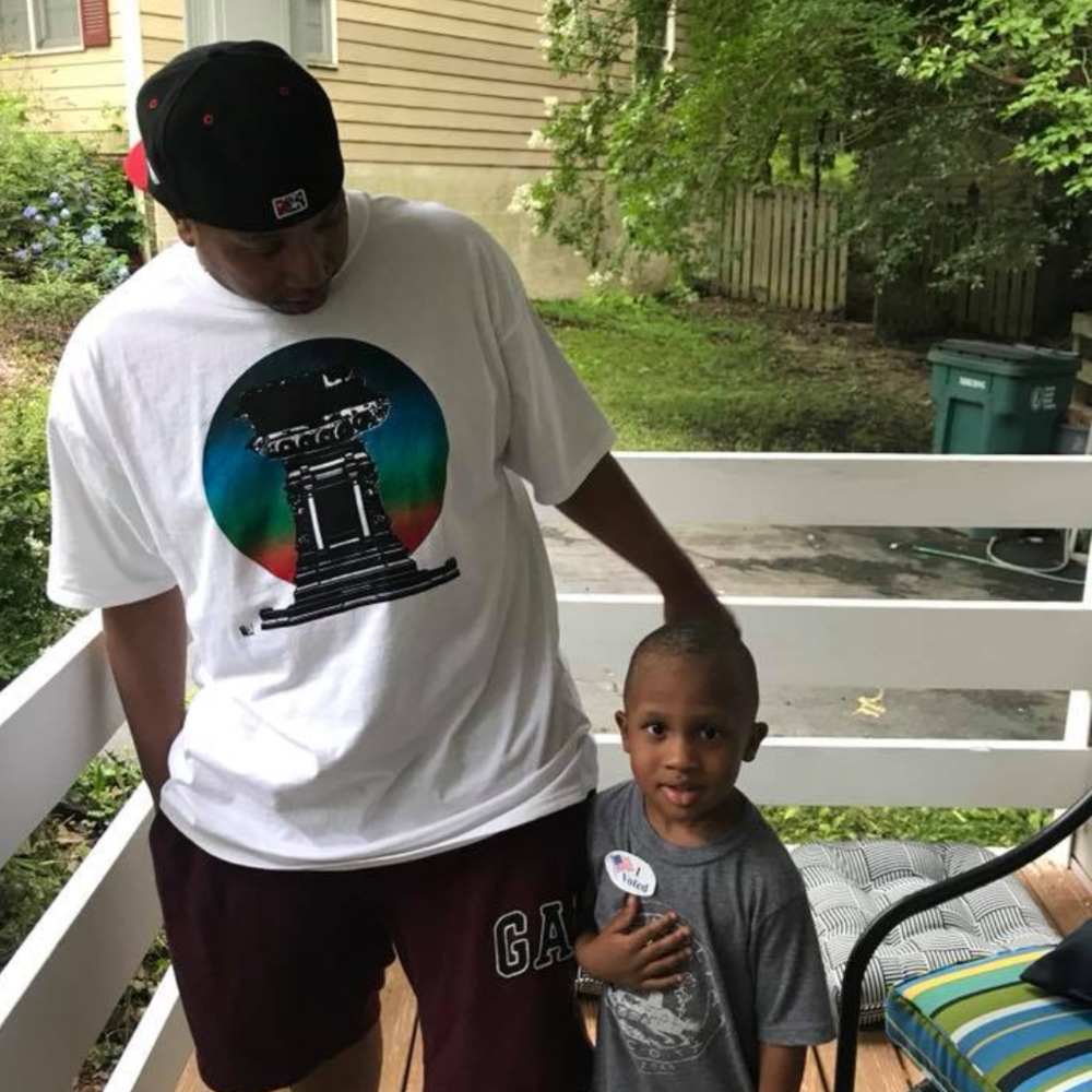Marc in the Tank Tee with son Cam