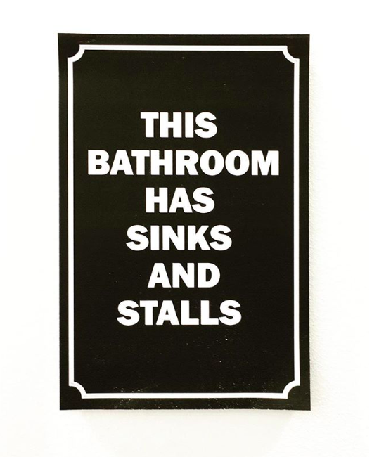 The signs outside our multi-stall restrooms