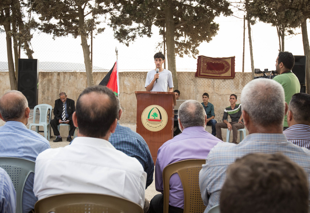 Aram addresses the crowd during the opening of Rosa Park, 2015.