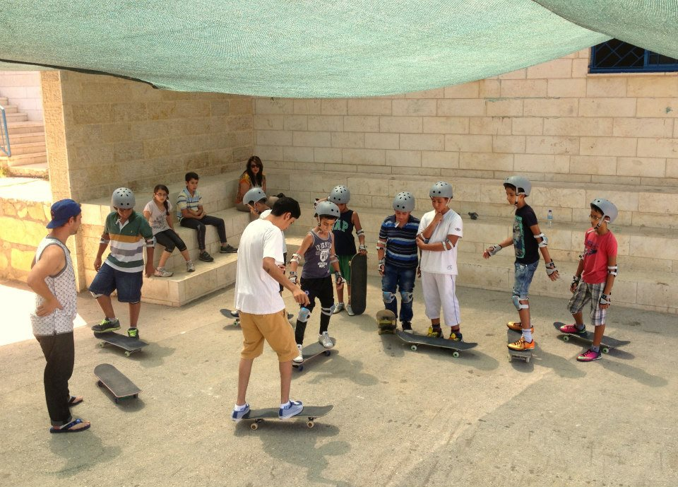 Aram & Charlie teach the basics during skate classes in Ramallah, 2014.