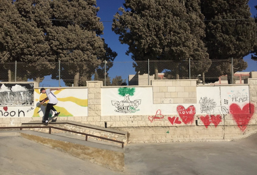 Jake takes a break from filming to 180 switch nosegrind at Asira Al-Shamaliya skatepark.