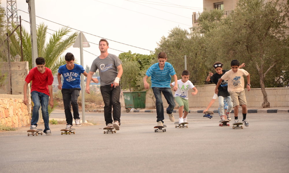 Charlie with some of the first skateboarders in Palestine, including Aram Sabbah, Adham Tamimi and Mai Alem.