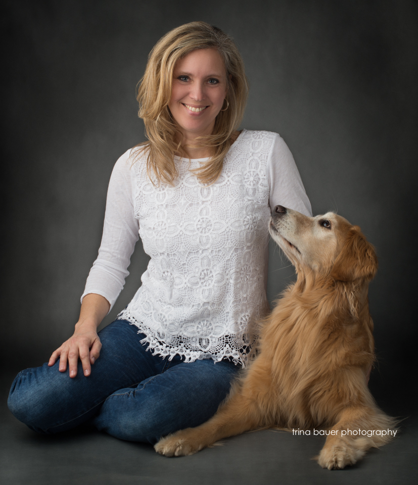 self.portrait.golden.retriever.woman