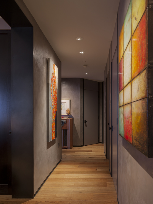 Hallway with metal base and casing, plaster walls, great art and recessed art lighting