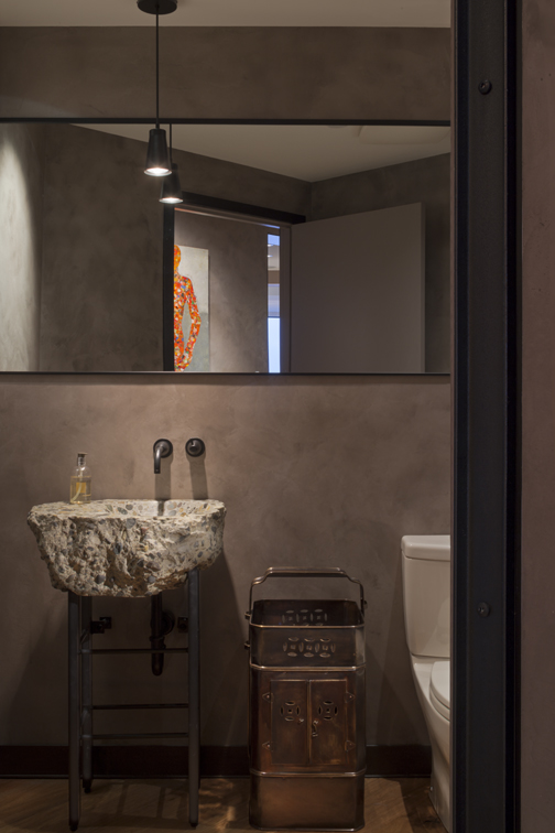 Seattle contemporary Powder Room design showing custom concrete sink handmade from piece of local Seattle highway, metal legs, full width mirror, pendant and towel rack