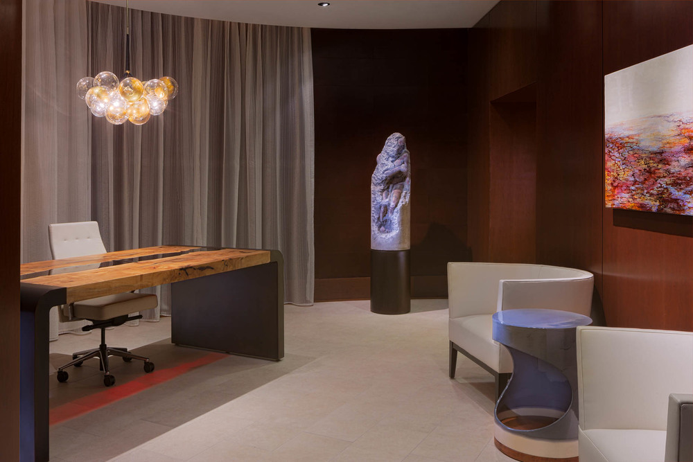 Seattle Hotel 1000 Madison Tower Lobby with white tile floor, custom maple, glass and metal table, local Seattle art, cherry built-in cabinets and leather wall panels