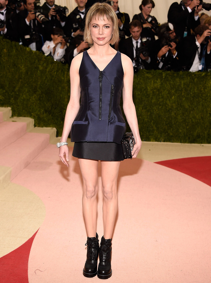 Michelle Williams' sad-sack Vuitton dress and combat boots caused a stir at the Met Gala. Via Getty.
